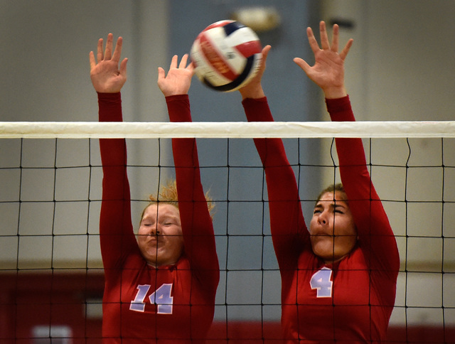 Western's Camille Riggs (14) and Elaina Tillmond block the ball against Pahrump Valley ...
