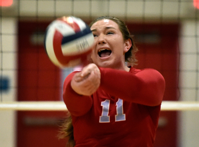 Western's Nikki Riggs hits the ball against Pahrump Valley during a high school volley ...