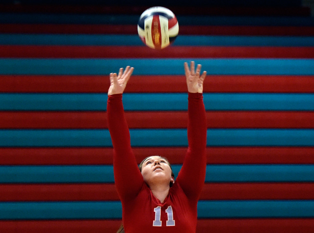 Western's Nikki Riggs sets the ball against Pahrump Valley during a high school volley ...
