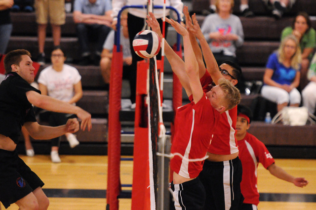 Las Vegas Chris Kampshoff (9) and Guillermo Gonzalez (7) block a spiked by Valley's Za ...