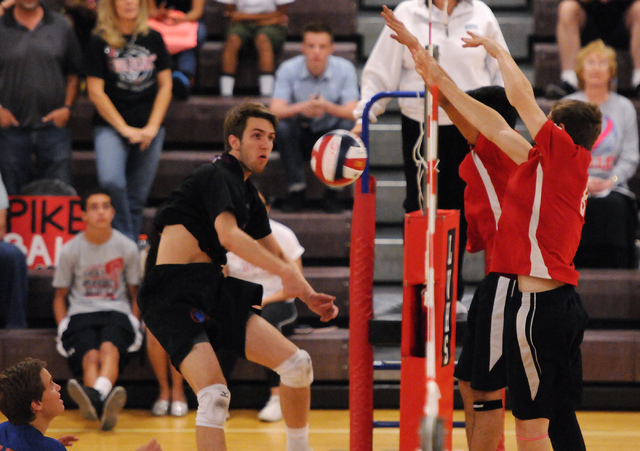 Las Vegas' Chris Marx (8) and T.J. Esporas (2) block a spike ball from Valley's ...