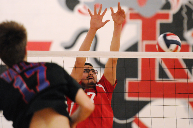 Valley's Jack Heavey (17) spikes the ball over Las Vegas' Guillermo Gonzalez (7) ...