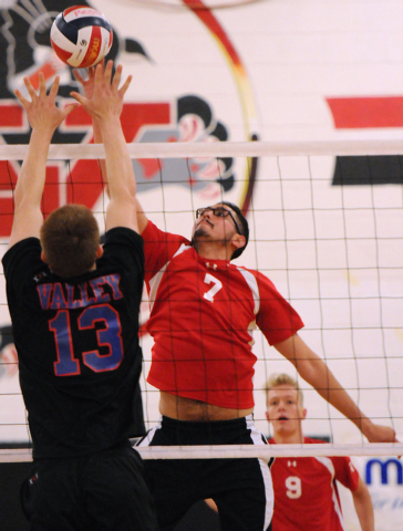 Las Vegas' Guillermo Gonzales (7) spikes the ball over Valley's Zack Ross (13) d ...