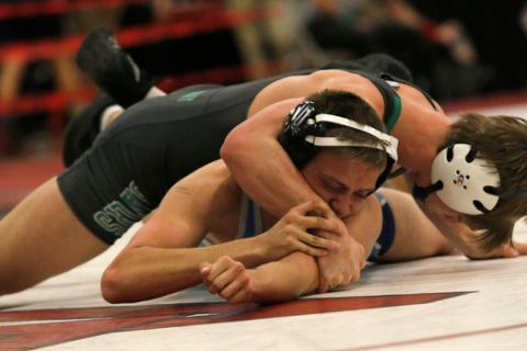 Green Valley's Wallace Zernich, top, crossfaces Foothill's Steven Lopez during a ...