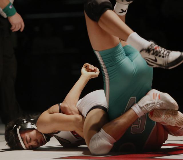 Las Vegas's Antonio Saldate, white singlet, attempts to pin Green Valley's David ...