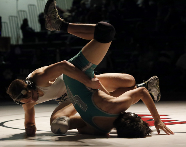 Foothill's Wyatt English, left, wrestles Green Valley's Desmond Bowers during a ...