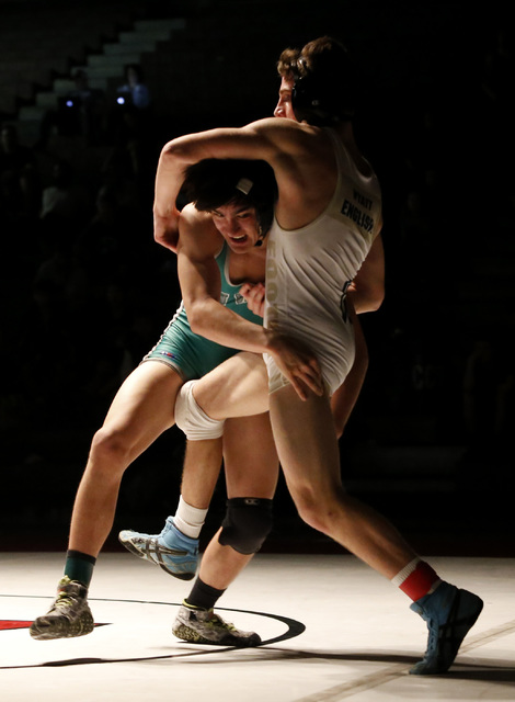 Green Valley's Desmond Bowers, left, shoots on Foothill's Wyatt English during a ...