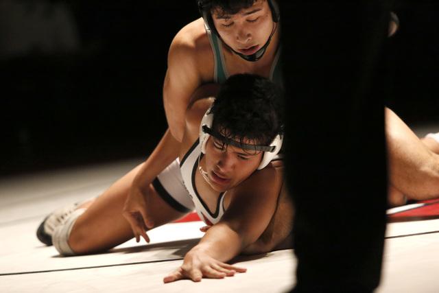 Green Valley's Giulian Nakamastu, top, wrestles Las Vegas's Jakob Alvarado durin ...