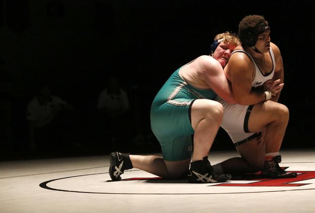 Green Valley's Anthony Valenti, green singlet, wrestles Las Vegas's Robert Keamp ...