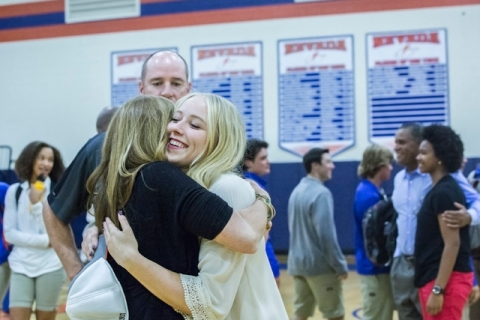 Bishop Gorman's Abbey Archambault hugs her mother Nancy Archambault during an event fo ...