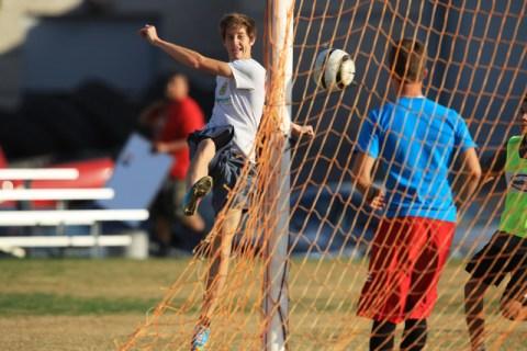 Cimarron-Memorial soccer player Garrick Quackenbush launches a shot during practice Wednesda ...