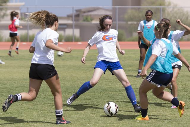 Hannah Borgel (24), center, kicks the ball during girls soccer practice at Bishop Gorman Hig ...