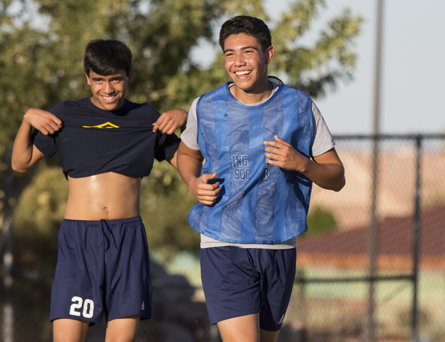 Spring Valley soccer player Jose Lopez, right, jokes around with teammates during practice ...