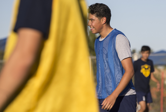Spring Valley soccer player Jose Lopez (7) jokes around with teammates during practice on We ...