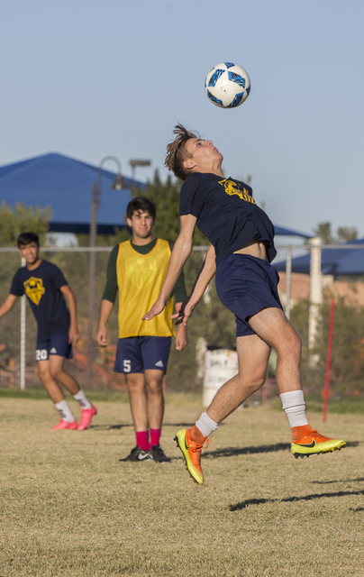 Spring Valley soccer player Ethan Orme (11) goes up for a header during practice on Wednesda ...