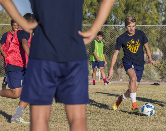 Spring Valley soccer player Ethan Orme (11) dribbles past defenders during practice on Wedne ...