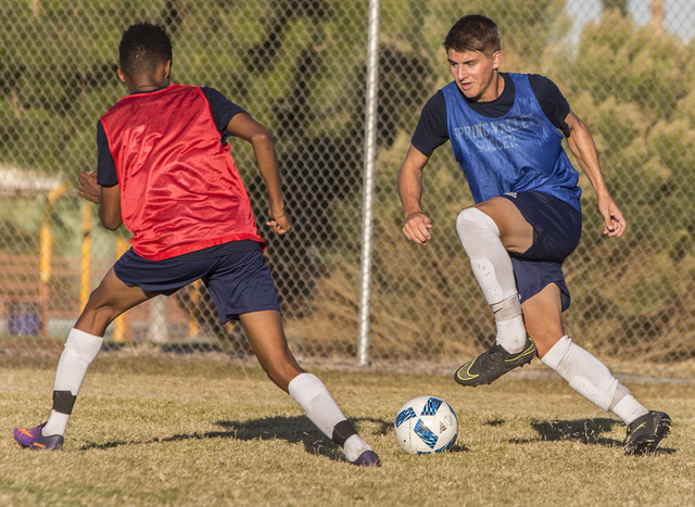 Spring Valley soccer player David Van Hoose, right, sprints past a defender during practice ...
