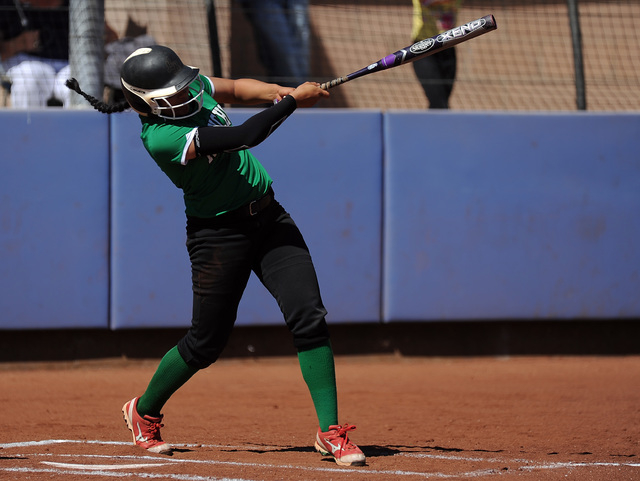Rancho infielder Tiare Lee hits an RBI double against Bishop Gorman in the first inning of t ...