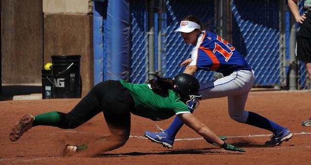 Rancho base runner Gianna Carosone is tagged out by Bishop Gorman third baseman Morgan Blann ...