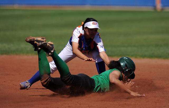 Bishop Gorman shortstop Sierra Dias tags out Rancho base runner Kayla Coles after Coles atte ...
