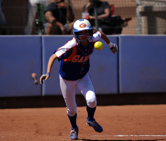 Bishop Gorman player Monique Passalacqua bunts her way to first base against Rancho in the f ...