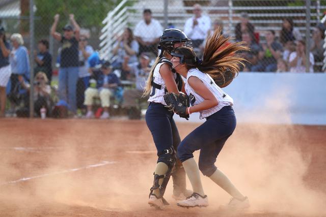 Foothill catcher Hannah Stevens, left, and pitcher Sarah Penska celebrate an 8-7 win over Co ...