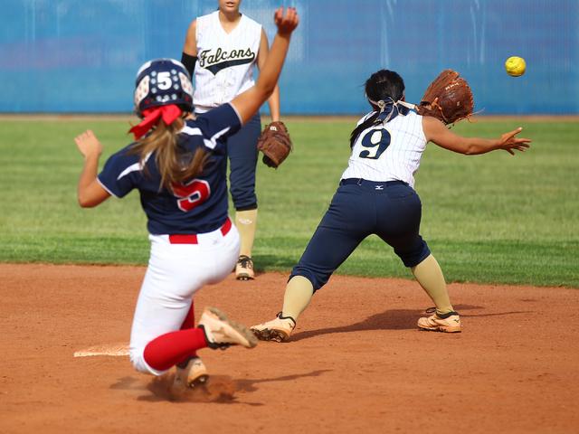 Foothill's Alexia Campbell (9) reaches for a throw as Coronado's Nicole Hardy (5 ...