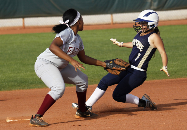 Faith Lutheran shortstop Cheyenne Kidd (8) tags out Cheyenne's Kylie Clark (1) trying ...