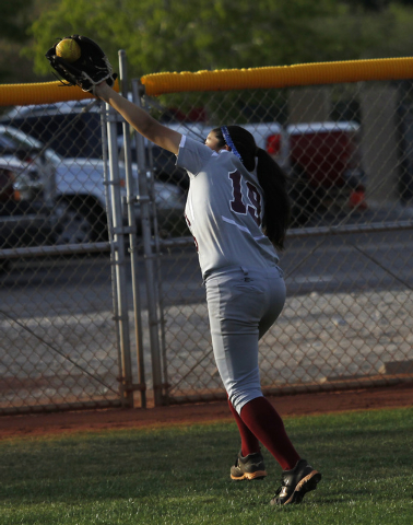 Faith Lutheran's Vanessa Valdez (19) makes a running catch in the outfield to record t ...