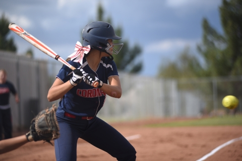 Coronado's Basia Query (9) swings at a pitch against Rancho during their softball game ...