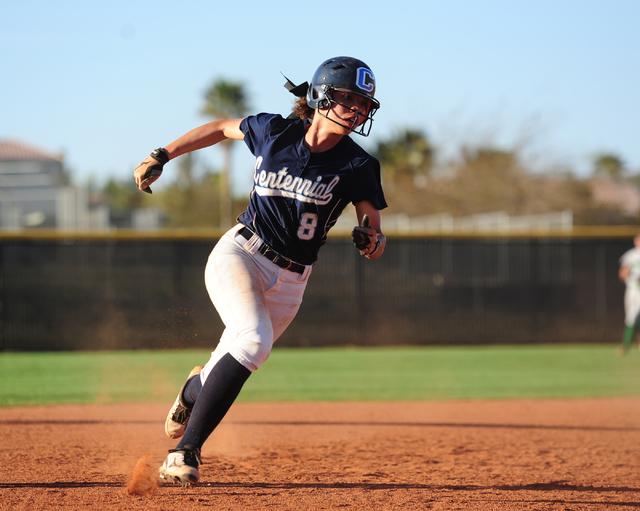 Centennial base runner Angel Love scores a run in the seventh inning of their prep softball ...