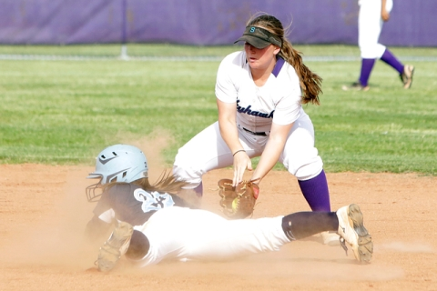 Foothill's Katelyn Enzweiler slides head first at second as Silverado's Alexa Os ...