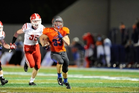 Bishop Gorman's Jonathan Shumaker runs for a touchdown against Brophy Prep in the firs ...