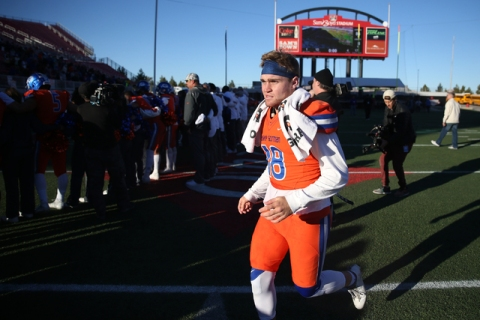 Bishop Gorman's Tate Martell (18) runs to meet with his teammates after winning 84-8 a ...