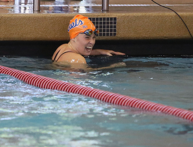 Bishop Gorman's Amy Lubawy smiles after she competes in the 100-yard freestyle during ...