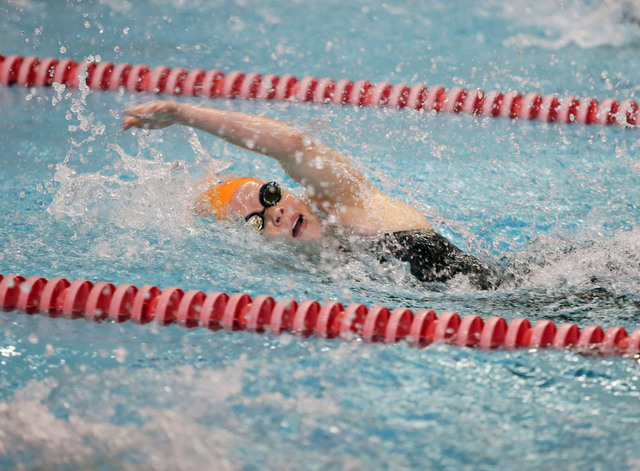 Bishop Gorman's Rachel Boodt prepares to turn while swimming the 100-yard backstroke durin ...