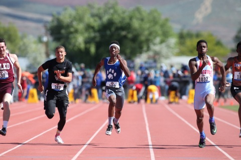 Desert Pines' Artis McCoy, center, competes in the 1-A Boys 100 at the NIAA track and ...
