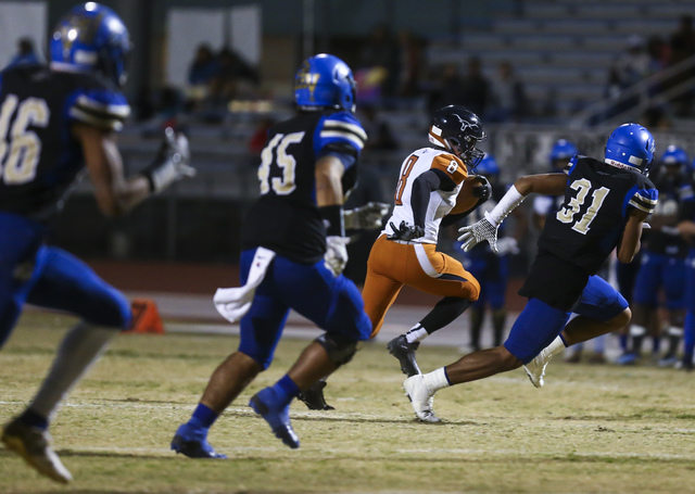 Legacy Marquell Evans (8) runs the ball against Sierra Vista during a Sunset Region quarterf ...