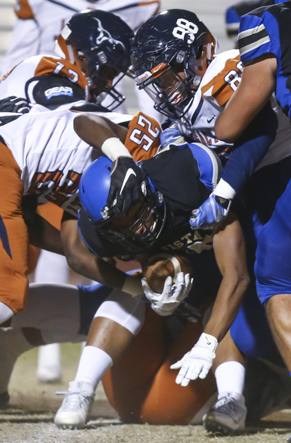 Sierra Vista's Isaiah Zavala (25) is tackled by Legacy defense, including Legacy&#8217 ...