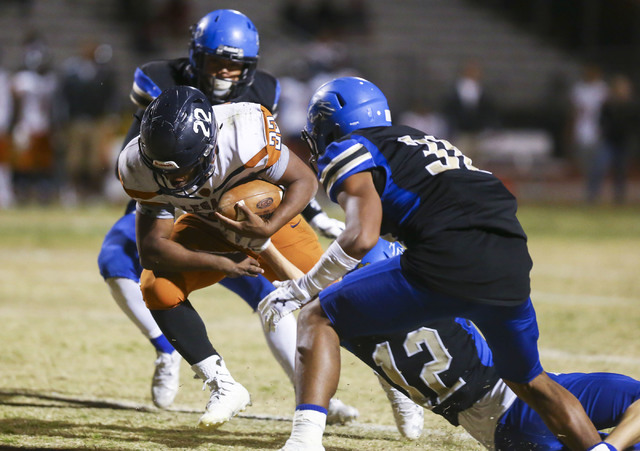 Legacy's Samuel Turner (22) is tackled by Sierra Vista's Trevor Gentner (12) dur ...