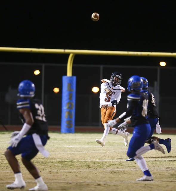 Legacy quarterback Roberto Valenzuela (5) throws the ball while playing against Sierra Vista ...