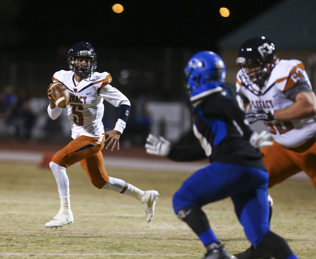 Legacy quarterback Roberto Valenzuela (5) looks for an open pass during a Sunset Region quar ...