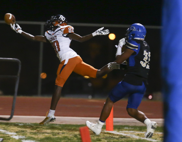 Legacy wide receiver Elisha Jackson (80) attempts a catch just outside of the end zone while ...