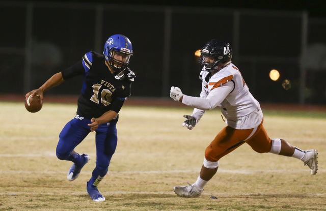 Sierra Vista quarterback Oscar Aliaga (10) looks for an open pass as Legacy's Jalen Al ...