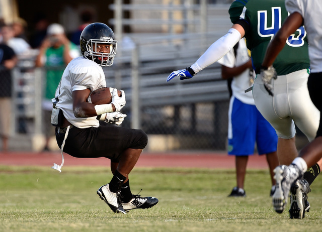 Las Vegas High's Elijah Hicks runs with the ball during a scrimmage against Green Vall ...