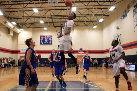 Las Vegas forward Tyler Bey sails in for a dunk against Orem at the Tarkanian Classic on Thu ...