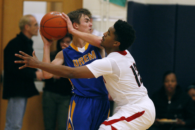 Las Vegas guard Devon Colley defends Orem guard Jake Stayner during their game at the Tarkan ...