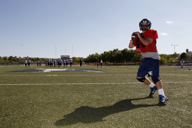 The Meadows quarterback Jake Gleason steps back for a pass during practice. Gleason passed f ...