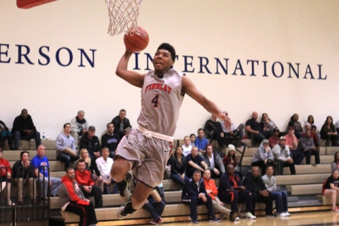 Findlay Prep guard Allonzo Trier leaps to dunk against Westwind during their game Tuesday, N ...