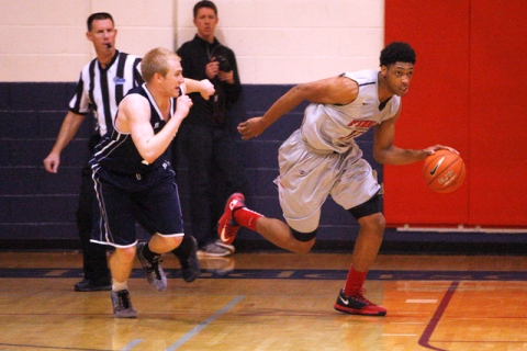 Findlay Prep forward Justin Jackson takes the ball up court against Westwind during their ga ...